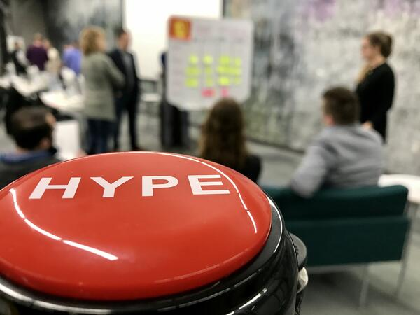 The SPARK HYPE button is shown in a team meeting.